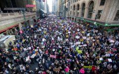 Women walking against Trump