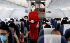 A flight attendant cecks on passengers