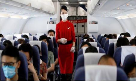 A flight attendant cecks on passengers