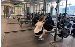 Jude Mishmash preforming a high-bar back squat