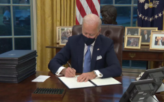 President Joe Biden signing a series of executive orders