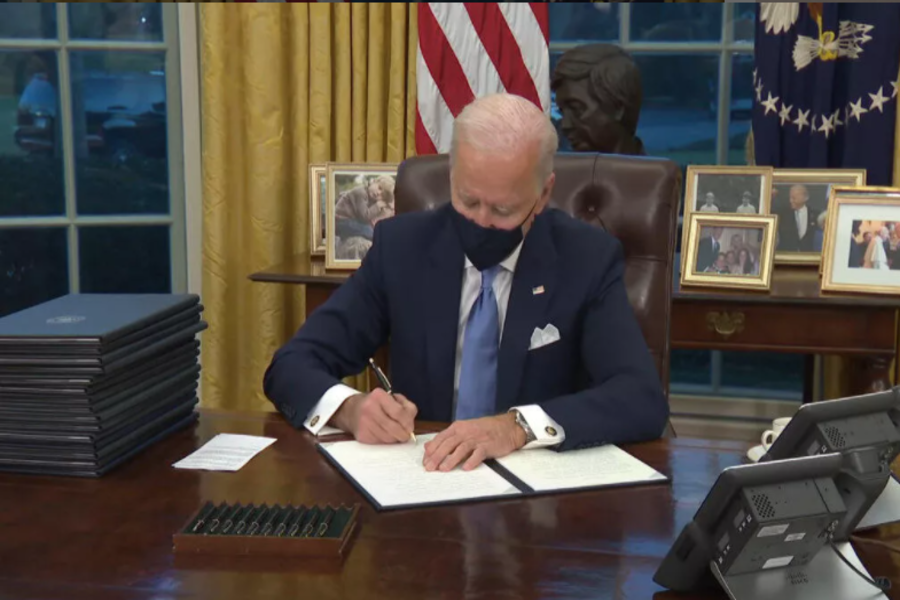 President+Joe+Biden+signing+a+series+of+executive+orders