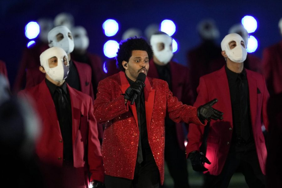 The Weeknd performs during the Pepsi Super Bowl LV Halftime Show at Raymond James Stadium on February 07, 2021 in Tampa, Florida. (Chris O'Meara/AP)