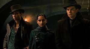 Scene from 'Shadow and Bone' of Jesper Fahey, Inej Ghafa, and Kaz Brekker.
